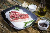 Raw beefsteak with rosemary, salt and pepper - GIOF03696