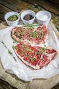 Row beefsteak with rosemary, salt and pepper - GIOF03699