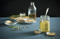 Homemade mustard in a glass with spoon, various ingredients - ASF06134