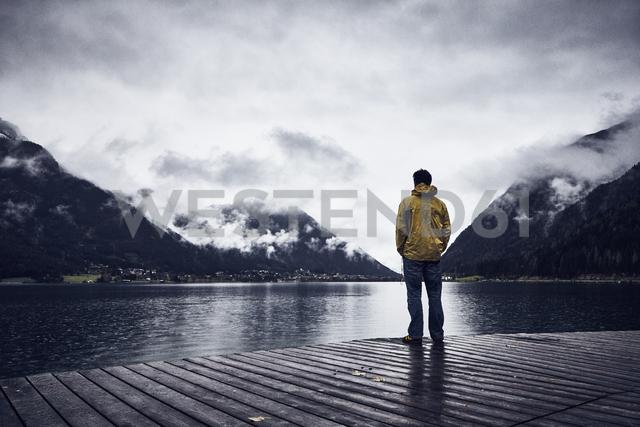 Austria, Tyrol, Lake Achen, man standing on boardwalk - RBF06230