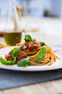Spaghetti with cherry tomatoes and basil on a plate - GIOF03716