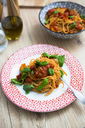 Spaghetti with cherry tomatoes and basil on a plate - GIOF03719