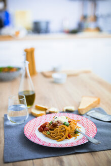 Spaghetti with cherry tomatoes and basil on a plate - GIOF03722