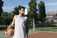 Man with basketball on basketball ground - ALBF00337
