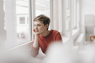 Pensive woman looking out of window - KNSF03281