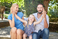 Portrait of happy family in garden - SRYF00634