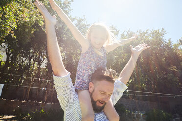 Happy father carrying daughter on shoulders - SRYF00643