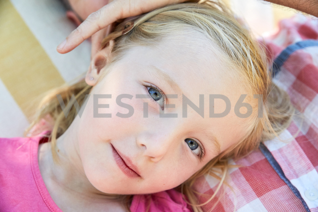 Portrait of smiling girl relaxing with father - SRYF00649