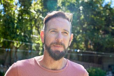 Portrait of bearded man outdoors - SRYF00670
