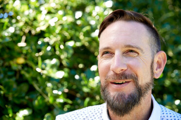 Portrait of smiling bearded man outdoors - SRYF00679