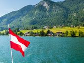 Austria, Salzkammergut, Salzburg State, Lake Wolfgangsee, St. Wolfgang, holiday homes and Austrian flag - AMF05586