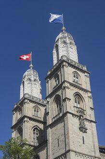 Switzerland, Zurich, great minster with swiss flag - JHEF00034