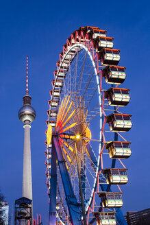 Germany, Berlin, TV Tower, Big Wheel at Christmas Market Alexander Square, blue hour - JHEF00037