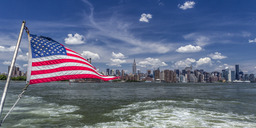 USA, New York, East River, American Flag, View to Midtown Manhattan - JHEF00043