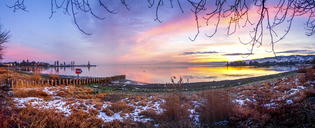 Switzerland, Thurgau, Lake Constance, Romanshorn in winter at sunset - PUF01034