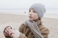Portrait of boy on the beach in winter - KMKF00104