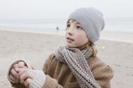 Portrait of boy on the beach in winter - KMKF00104