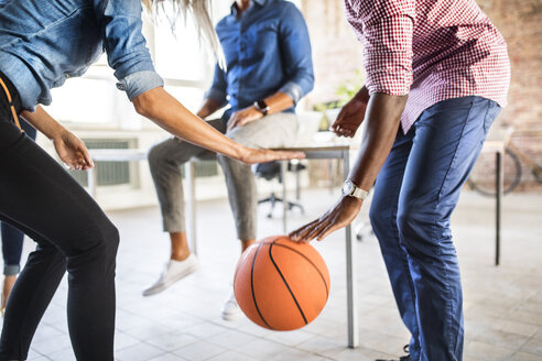 Colleagues playing basketball in office - HAPF02624