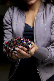 Woman's hands holding confetti - HHLMF00025
