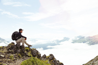 Austria, South Tyrol, hiker lookint at view - FKF02863