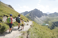 Austria, South Tyrol, family hiking - FKF02869