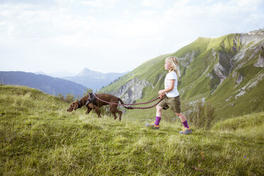 Austria, South Tyrol, young girl hiking with dog - FKF02872