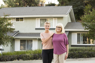 Portrait of smiling woman with mother in front of a house - MFRF01144