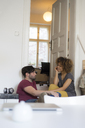 Young couple at home relaxing and talking - HHLMF00131