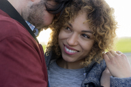 Portrait of smiling young couple close together outdoors - HHLMF00137