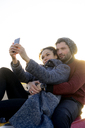 Young couple taking selfie outdoors - HHLMF00146