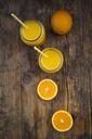 Freshly squeezed orange juice in jars with straws - LVF06575