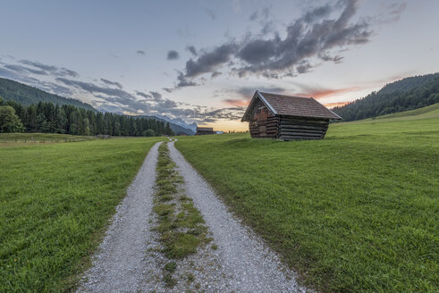 Germany, Bavaria, Werdenfelser Land, hay barn at sunrise - RPSF00079