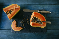 Papaya cut on slate plate - KIJF01816