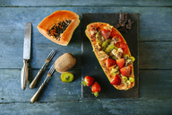 Papaya with kiwi, banana and strawberries with chocolate shavings on top - KIJF01843