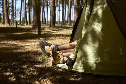 Shoes are sticking out of a tent in forest - SRYF00718
