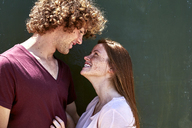 Smiling young couple in love looking at each other - SRYF00754