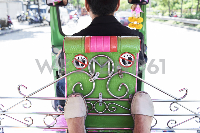 Thailand, Bangkok, feet of a traveler and forbidden sign inside a tuk tuk - IGGF00343