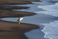 Indonesia, Bali, young woman with surfboard - KNTF00961