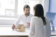 Man explaining architectural model to woman - MOEF00645
