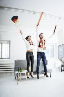 Excited German football fans cheering - MOEF00654
