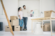 Couple moving into new home making plans - MOEF00678