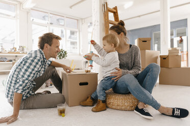 Happy family moving into new home - KNSF03392
