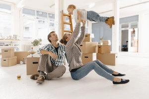 Happy family moving into new home - KNSF03395