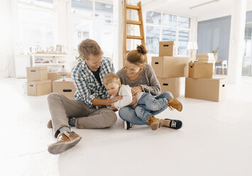 Happy family moving into new home - KNSF03401