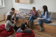 Group of students in dormitory eating pizza together - ZEDF01094