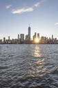 USA, New York City, Manhattan, New Jersey, cityscape at sunset - RPSF00130