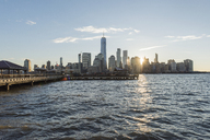 USA, New York City, Manhattan, New Jersey, cityscape at sunset - RPSF00133