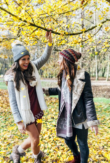 Two pretty women having fun in an autumnal forest - MGOF03723