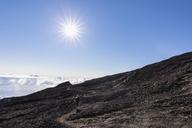 Reunion, Reunion National Park, Shield volcano Piton de la Fournaise, female tourist hiking to crater - FOF09648