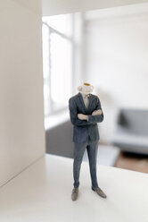 Businessman figurine with coffee cup head standing in office - FLAF00055